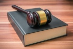 Wooden gavel on book. Justice and law concept.